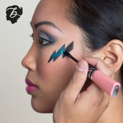 Layer any blue glitter mascara or shadow over black for extra color payoff! Our artist uses a little prrrowl to create a glam-rock lightening bolt. http://www.benefitcosmetics.com/product/view/prrrowl-mascara-lip-gloss