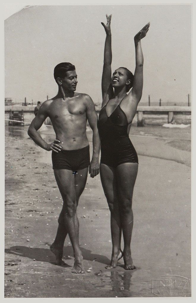 "The ""Ebony Venus"" and the ""Bronze Apollo"" - Josephine Baker and the Russian-born French ballet legend, Serge Lifar, on the Lido beach in Venice, 1930s."