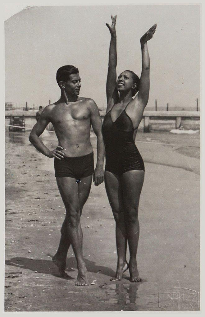 "The ""Ebony Venus"" and the ""Bronze Apollo"" - Josephine Baker and the Russian-born French ballet legend, Serge Lifar, on the Lido beach in Venice, 1930s."