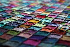 """""""Insanity Blanket"""" 2x2 knit squares made with yarn donated from many of her friends, it's so colourful and beautiful!! Tutorial on The Heathen Housewife Blog: http://www.shellykang.com/all-about-the-blankie"""