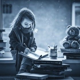 Adorable little girl, writing letter to Santa, sitting on a wind, Adorable little girl, writing letter to Santa, sitting on a window, books and teddy bear around