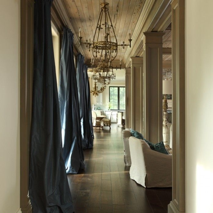 Blue Silk Curtains Beautiful Living Room Features Planked Ceiling Dotted With Brass French Chandeliers Alongside