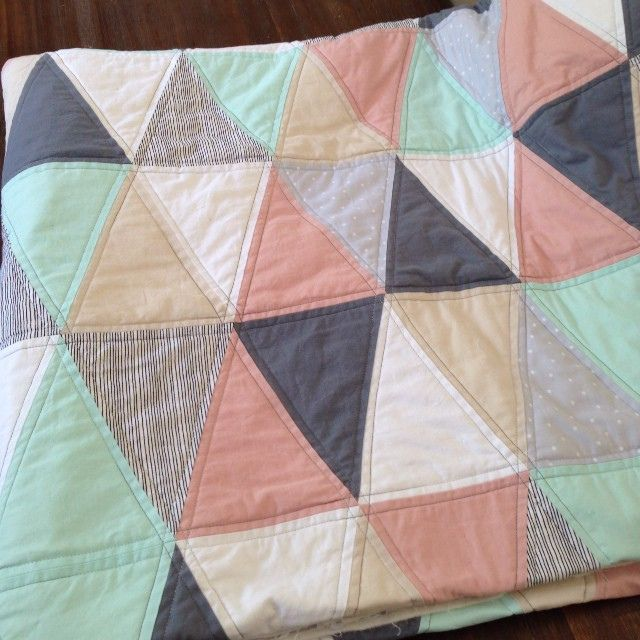 Triangles patchwork quilt. Love the pastel colour combination.