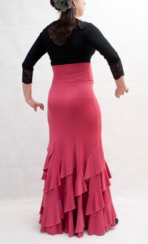 Flamenco Practise Skirt, with a high waist. Fitted at the hips and wide at the bottom. Beautiful garment with spiralling ruffles. Made from stretch soft touch lycra jersey fabric, soft and smooth texture giving a silky peach skin feel. Perfect for your practice and performing. Made to order. Required measurements: Waist Hips Length from waist to ankle