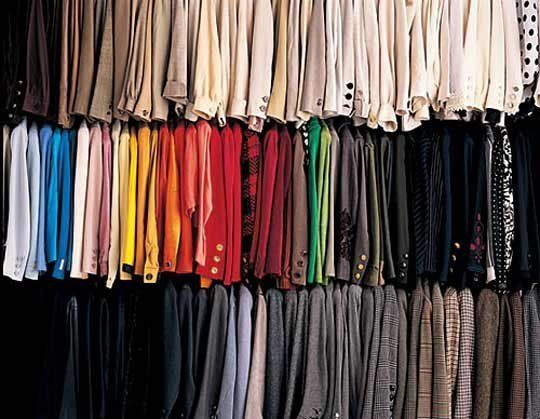 Organize your closet by type: put all the jackets together, all the button down shirts together, all the good pants together, all the jeans together. Now, organize your closet by colour: From left to right, from white to black, from light to dark or use ROYGBV (red, orange, yellow, green, blue, violet). Face all your clothes the same way: You've gone through the trouble of getting matching hangers, now face all your clothes the same way.