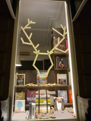 Rudolph made from sticks for a window display in a retail store window. Christmas retail window decorating