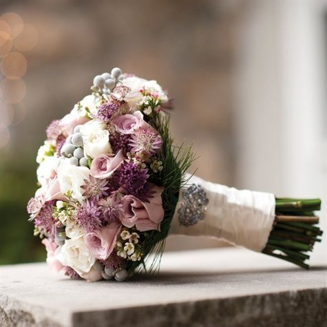 Faith roses, astrantia roma and spray roses in shades of ivory, pink, purple and silver made up Laura's bouquet.