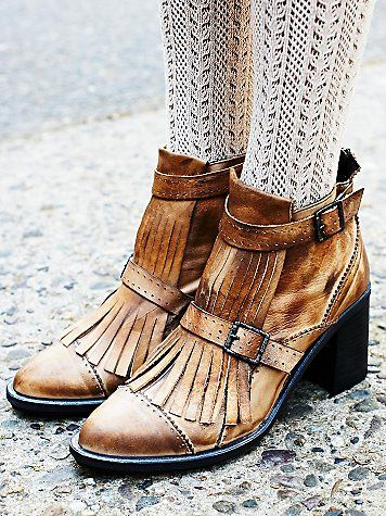 Free People Circle Back Heel Boot | Distressed leather ankle boot featuring a pointed toe with fringed tassel detailing.