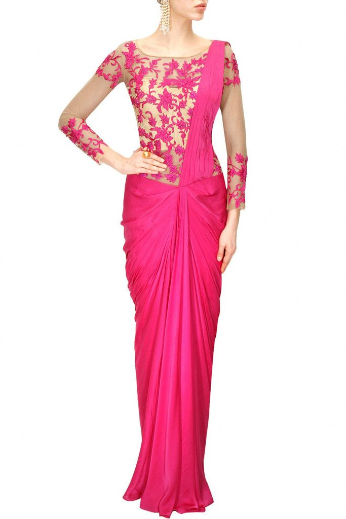 This pink colour saree gown is in satin gorgette georgette with pink thread floral embroidered swiss net sheer bodice. It has an attached inner. This saree gown is must be a piece of your wardrobe. Th