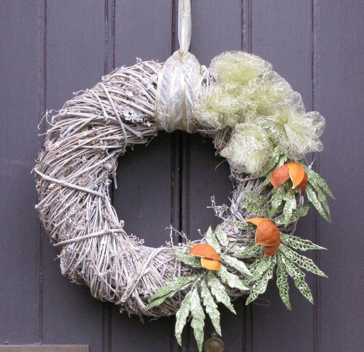 White wash wicker Christmas wreath with orange peel flowers and green glitter leaf detail by HostasAndGarden on Etsy