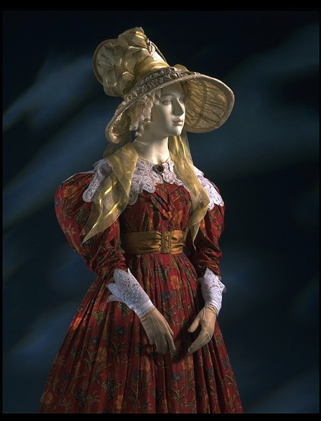 ca 1830, Netherlands, pale yellow silk bonnet, large wide ruched and caned brim and high poke, trimmed with wide ribbons of yellow silk gauze with opaque satin stripes and wired shapes of the silk with bound edges