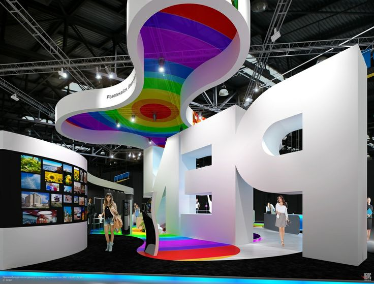 This custom exhibit booth uses large lettering to make the logo double as the front wall.