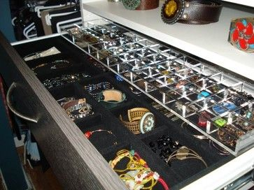 nice little square compartments for bracelets and watches.  I've yet to see one with the rows of velvet hills that you stick rings into.