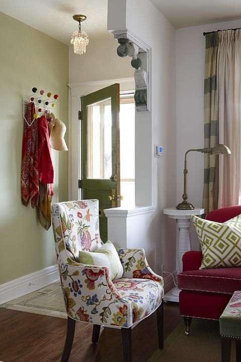 Chair covered in Braemore Wonderland Pearl fabric, from Sarah Richardson. Love the chair,pony wall, pedistal, and that cute coat hook thingy.