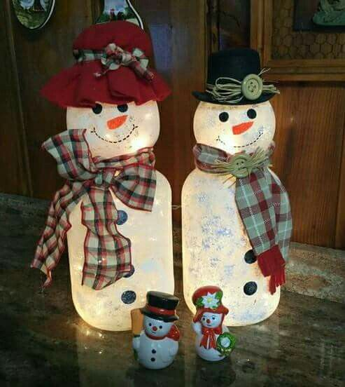 Snowmen Made Out Of Pickle Jars And Light Globes Via