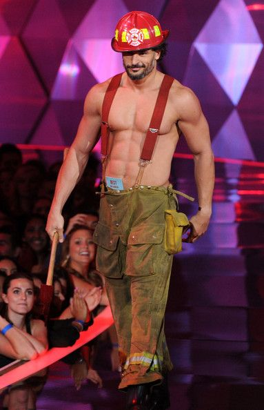 Joe Manganiello dresses up as sexy fireman for 2012 MTV Movie Awards. He presented the Best On-screen Transformation Award to Elizabeth Banks, and then he carried her off stage!