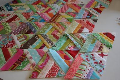 crazy mom quilts had this easy sew and flip and trim triangle project. I can use this to get rid of the bits and pieces of fabric I hoard.