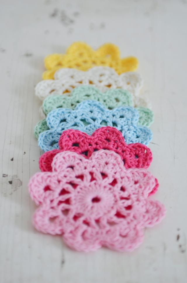Because I know you are fascinated with both crochet and girly things lately...  a tutorial for crocheted flower coasters.  Like granny squares but circles!  I'll take a set in pink, please.  Any pink you like.