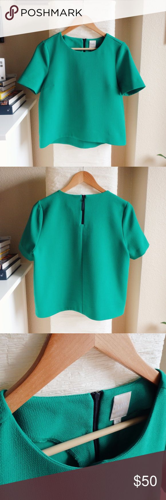"""Emerald Green Short Sleeve Blouse Amazing crepe short sleeved top - Rich emerald green - 100% polyester - Back zipper closure - Measurements: Bust: 19 3/4"""", Length: 21"""" - Condition: Like new, no holes, stains or an signs or wear - Worn once - Smoke free, pet free home - Thanks for stopping by! Twik Tops Blouses"""