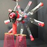 Recycle art, fantasy bird made of two empty bottles, old spanner, stop watch, paint roller, cups and pompoms. Great kids art and craft idea! get inspired at Studio Jean recycle club for kids. www.studiojean.nl