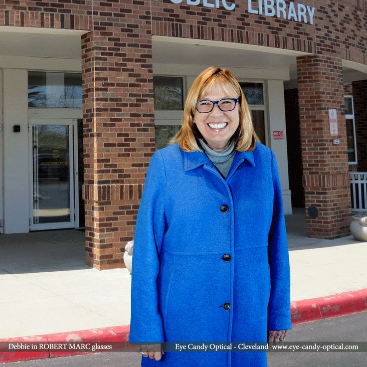 Debbie shows the Westlake Porter Library she means business in her new designer glasses by Robert Marc.  With Eye Candy no one pays Overdue Fines for an Eyewear makeover! Be who you want to be at Eye Candy Optical! info@eye-candy-optical.com www.eye-candy-optical.com - Book your Eye Exam Today! (440) 250-9191
