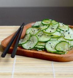 Japanese Cucumber Salad 2  Lg cucumber thinly sliced Sprinkle with salt set aside 5-10 minutes.  Gently wring out water, put in bowl. Mix together:  1/2 cup rice vinegar,