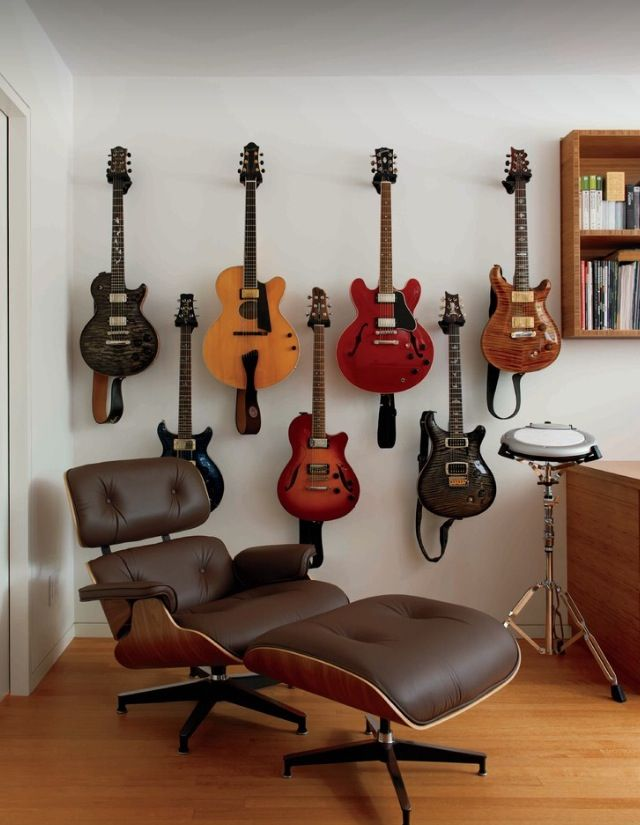 Guitar's hung up on the wall.