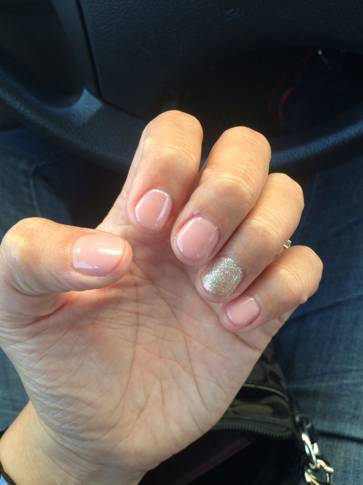 Short gel nails light pink.. With a hint of glitter