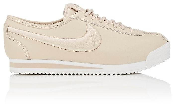 """$130 - Nike Women's Cortez '72 SI Leather Sneakers - Designed with a lightweight foam midsole, Nike's Cortez '72 SI low-top sneakers are crafted of cream smooth leather. 0.75""""/20mm midsole (approximately). Rounded toe. Embroidered logo patch at padded tongue. Embroidered swoosh logo appliqué at quarter panels. Printed logo at padded collar White and cream EVA midsole. Pinked edges. Tonal round laces. Lace-up style. Lined with mesh. Herringbone rubber sole. Available in Oatmeal (cream)…"""