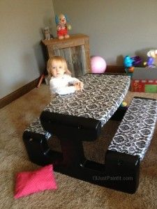 Great idea..paint and vinyl cloth on an ugly faded little tykes picnic table. I have to do this!