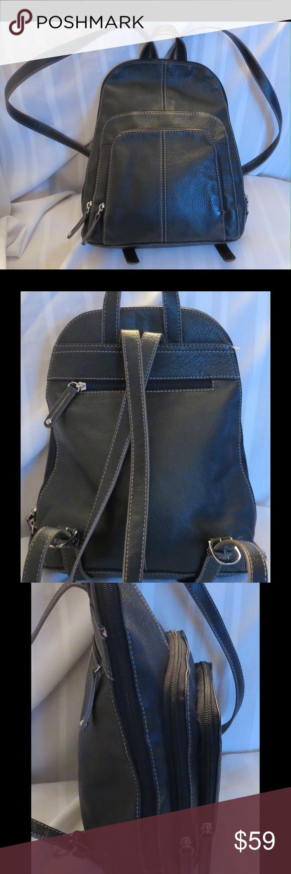 "Super Cute Tignanello Black Leather Backpack Bag Super Cute Tignanello Black Leather Backpack Bag  Excellent gently used condition Tons of different compartments 9 of them plus a bunch or credit card holder slots  All of my items are Guaranteed 100% Genuine I do not sell FAKES of any kind   Approx Measurements:   11""  X   9.5""  X  3""    No Trades (S086) Tignanello Bags"