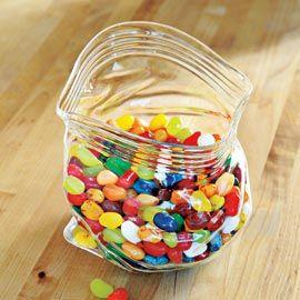 A glass bowl that looks like a ziploc bag.