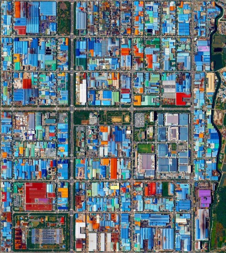 The colorful roofs of Songjeong-dong - an industrial district in Busan, South Korea - are seen in this Overview. The striking colors that you see here result from the use of aluminum roofing, which is used for its low cost and longevity.  Learn more at www.dailyoverview.com  Source imagery: @digitalglobe