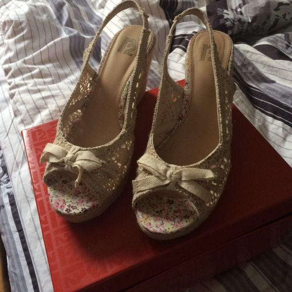 Cream wedges These are cream wedges with crochet detailing. Worn once! Great condition. These are a siZe 9 but I am a size 8.5 and It fits Shoes