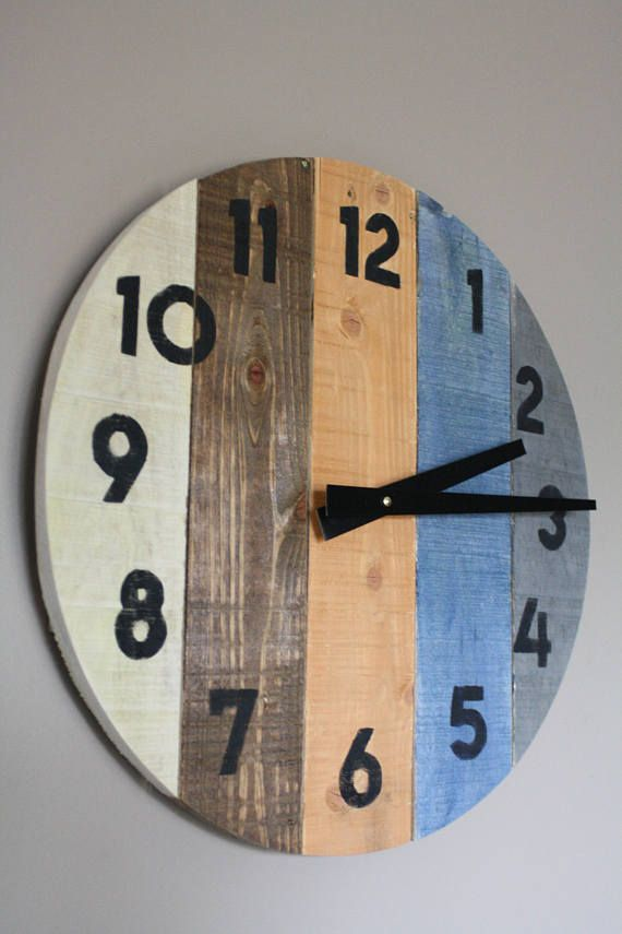 Welcome to the one and only terrafirma79 designs. Thank you for considering our artisan pallet wood clock shop for your home decor or gift giving needs. Here is a blend of neutral wood tones-warm and cool. The smoky blue color wash adds that perfect pop of color. This modern yet rustic