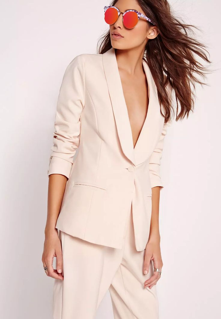 Strut from the boardroom to the bar in pure, effortless style and make sure you're ready for any situ. Featuring a high wearbaility nude hue, tailored style and two pockets to the front, this tailored blazer is a total beaut. Style with the...
