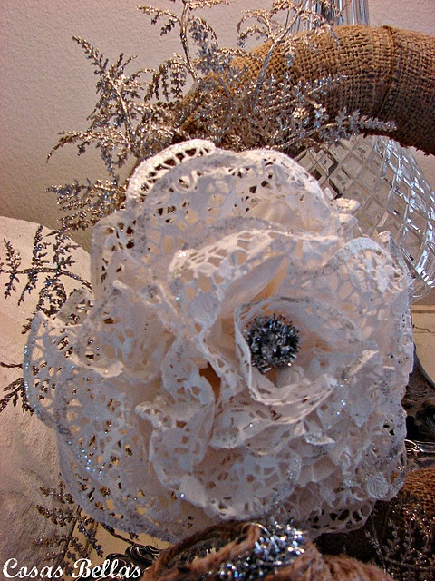 Paper doily flower... Is this what you mean, Tara/Teresa? Spray paint them yellow and incorporate them sparingly?