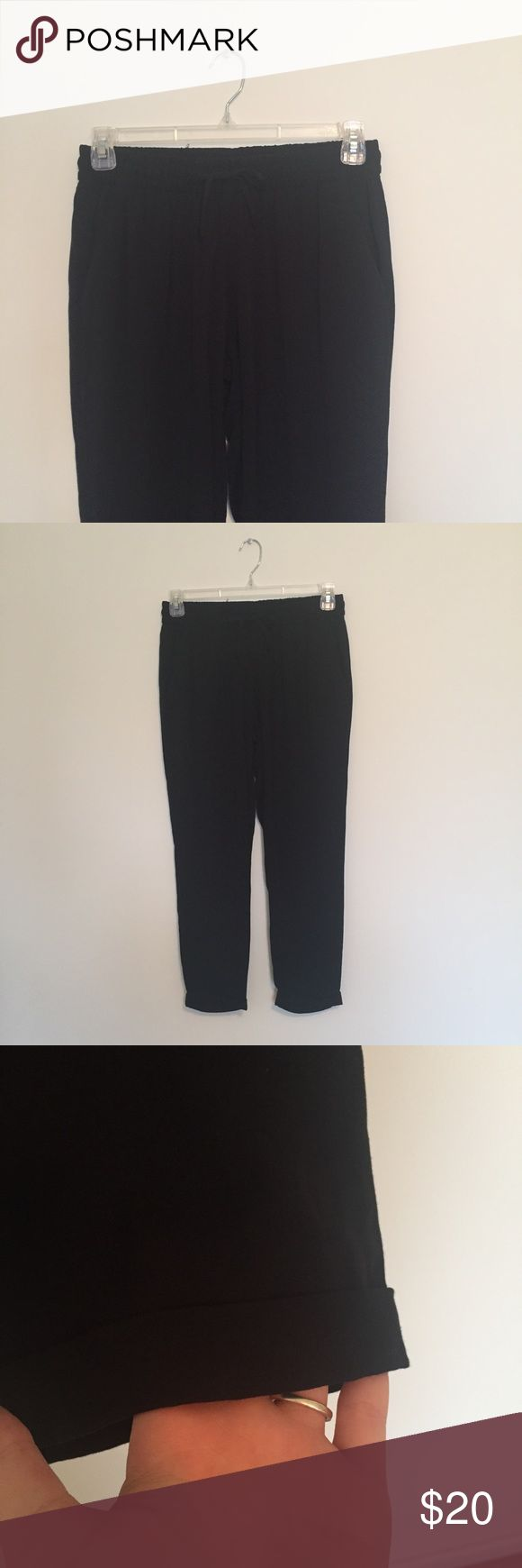 NWOT Business Casual Cuffed Joggers Never worn and in perfect condition. Casual black joggers made out of an almost silky material. Perfect to dress up with heels or nice flats and a button down for a business meeting. Or wear them with tees and converse. Have real pockets on the front and faux pockets on the back. Ties up with a drawstring. * NO TRADES * Old Navy Pants