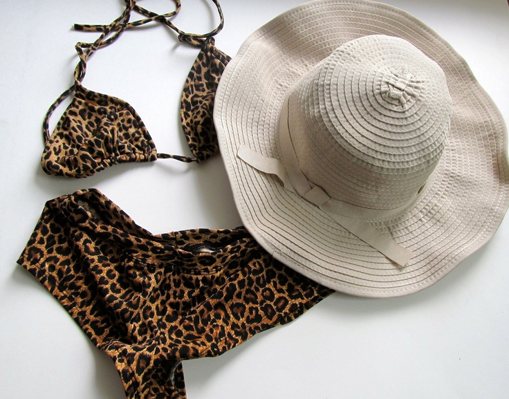 From The Skiny: Anti-sun gear is not all frumpy looking. Check out this Shapeable Poolside hat by Coolibar, $49. Flaunt it with your leopard bikini and viola: skin-savvy beach babe, you are.
