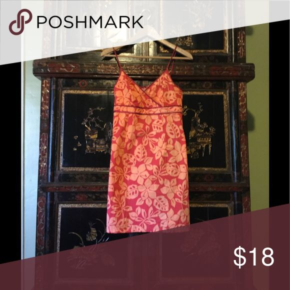 Hawaiian Floral Sun Dress Cute Hawaiian floral cotton sun dress is perfect for summer or spring. Shows off your curves. Color is orange floral over red background. Spaghetti straps and back zipper. Dress hits mid thigh, but it's not a mini-skirt; it's more above the knee. Unlabeled dress that I got in Hawaii. It's likely size small since I used to wear size 2-4. Excellent condition. Hawaiin Dresses Midi