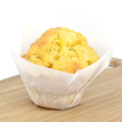 Baked corn muffins with cheese, chives and coriander - served with butter portions.