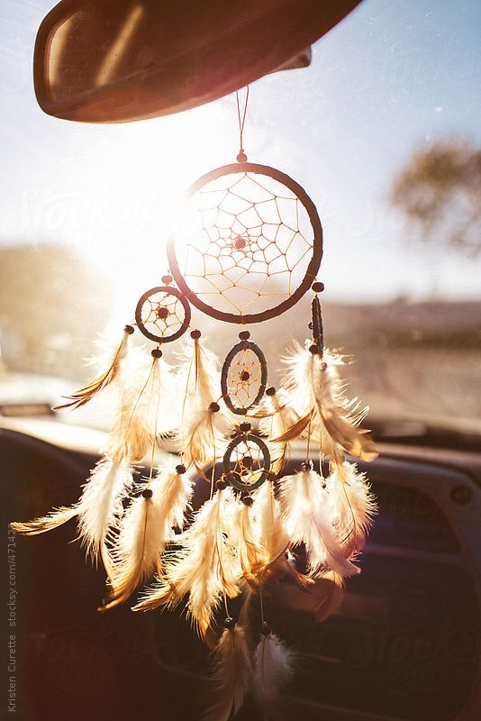 Dream catcher hanging from a car rear view mirror  by poorartist | Stocksy…