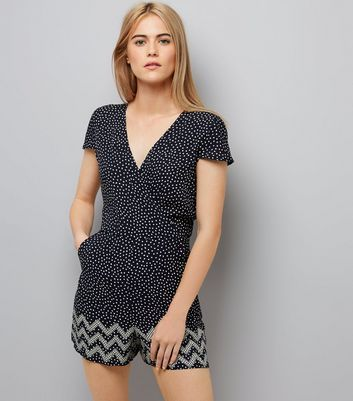 """Update your wardrobe with this playsuit. Combine with trainers for a casual look. - V neckline - All over spot print - Simple short sleeves - Wrap front - Mini length - Casual fit that is true to size - Model Squad model Emily is 5'7""""/170cm and wears UK 10/EU 38/US 6"""