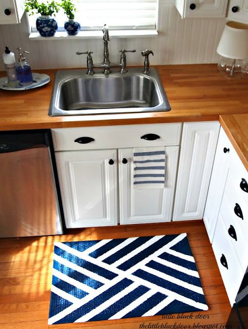 DIY Painted Rug - The Little Black Door (She is hilarious in her writing of the rug painting process)
