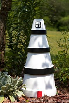 DIY Lighthouse Lawn Ornament! Simple to make, and will make a beautiful statement in your garden.