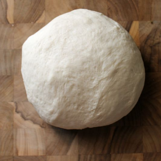 Pizza is a staple around my house, and with this Homemade Pizza Dough recipe it's easier than ever to make any pizza we can dream up!