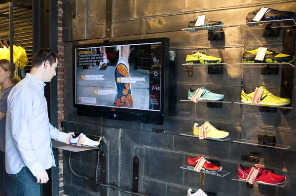 The store features an interactive RFID-enabled product immersion experience. Simply pick up a shoe and the RFID technology will do the rest, delivering customized content to you to help you learn more about the product, for whom it was designed and special features.  New Balance Boston, Copley Square.