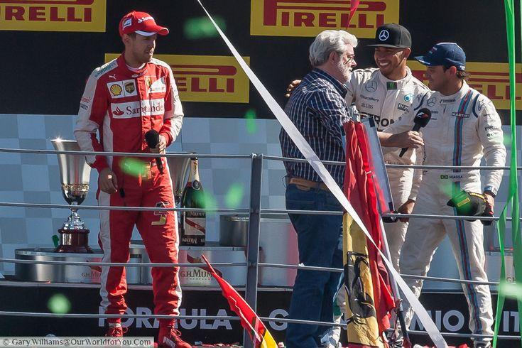 Lewis Hamilton, Phillipe Massa, Sebastien Vettel & George Lucas, on the  podium at the end of the 2015 Italian Grand Prix at Monza, Italy