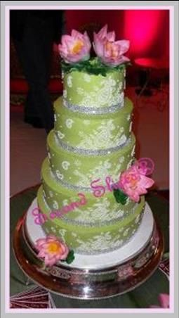 Custom Wedding Cake green with piping and Pink Lotus Flowers in gumpaste from Second Slices®