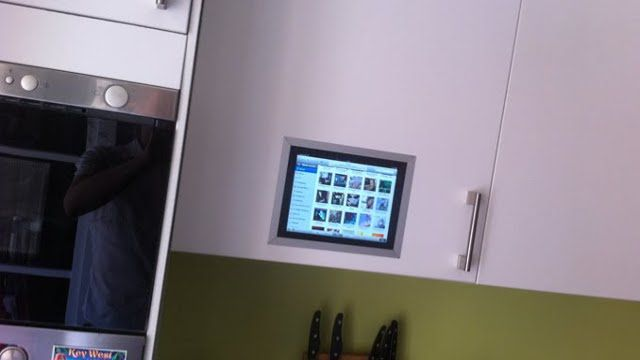 Tablet mounted in cabinet door.